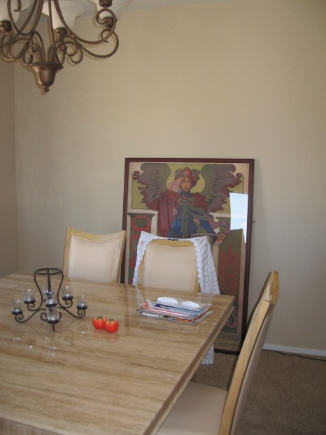Dining area with large single picture